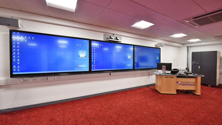 View of MR028 showing the teaching wall with its three 84 inch touchscreen monitors