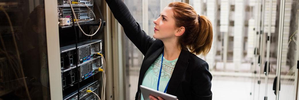 Engineer checking server room