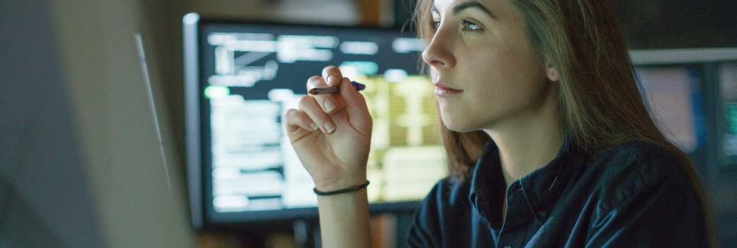 Woman working using multiple monitors