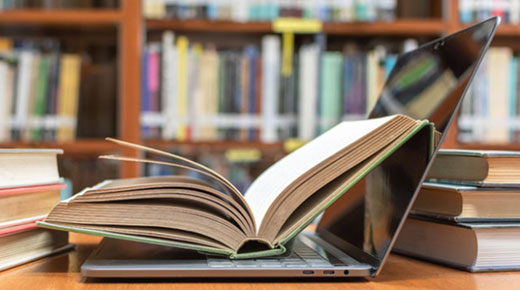 Laptop and books in the library