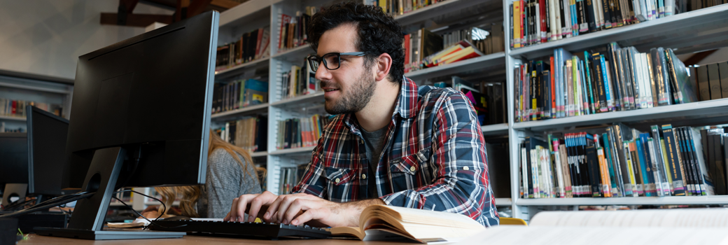 Library researcher at a computer