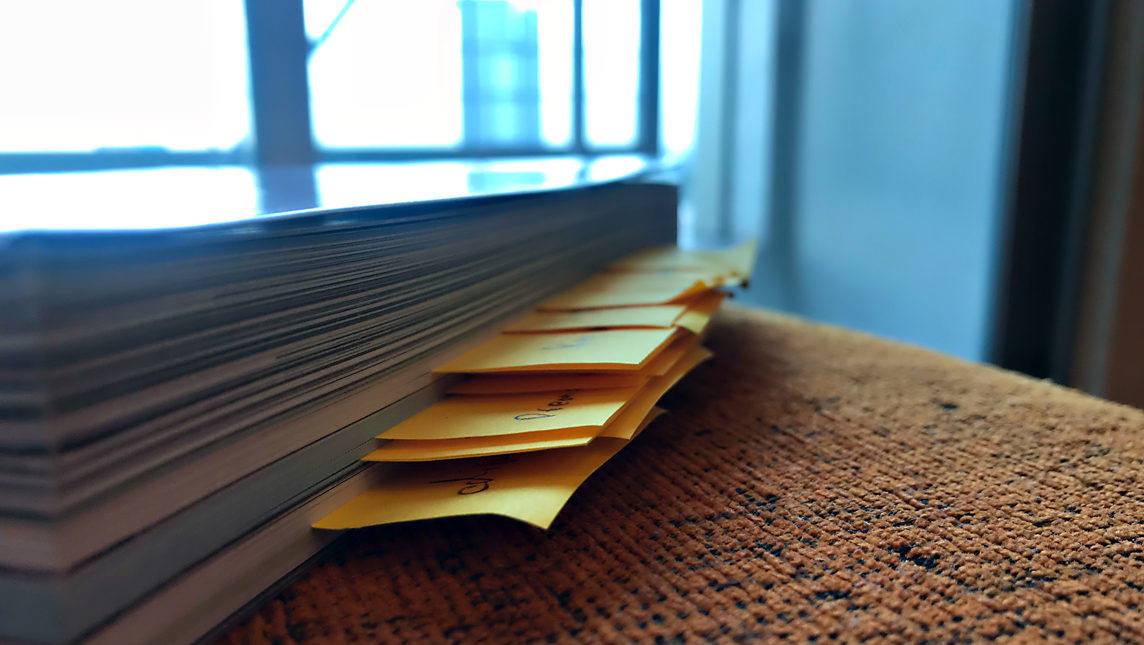 Paper pile with sticky notes