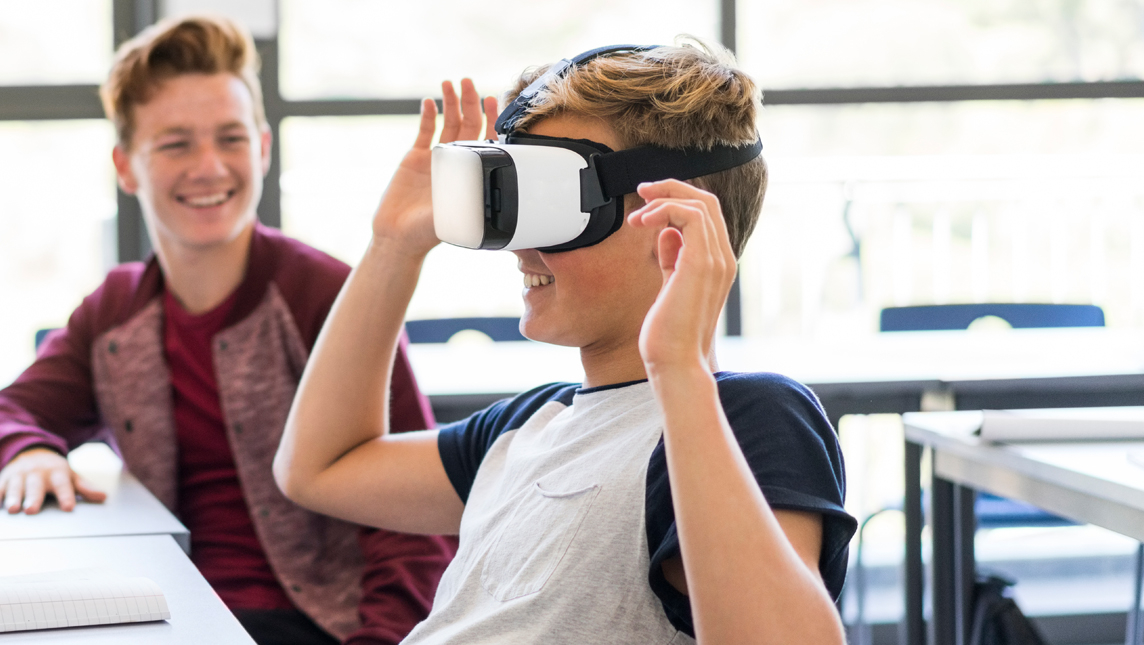 Student using VR headset in class