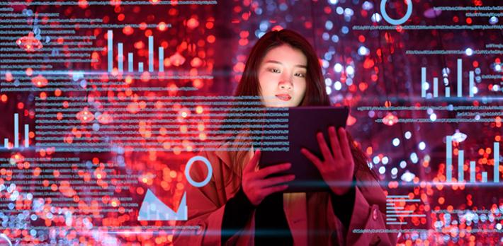 Woman using tablet and virtual visual screen