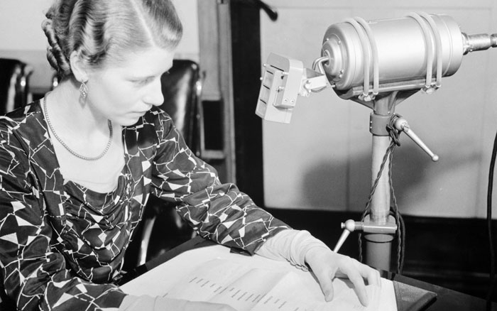 Jane Cain, the first voice of the Speaking Clock, recording messages for it (1935)