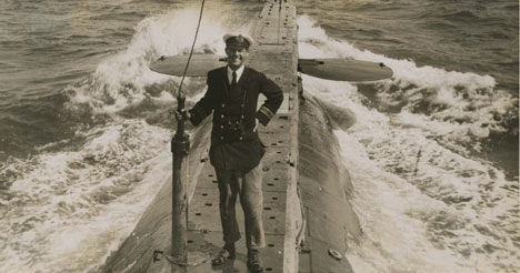Photograph of Lt Cdr Edward Courtney Boyle on deck of RN submarine E 14 (photograph stopped by censor)