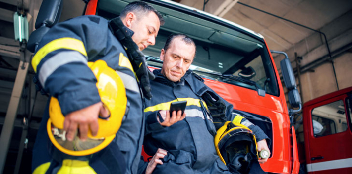 Firefighters using a smartphone