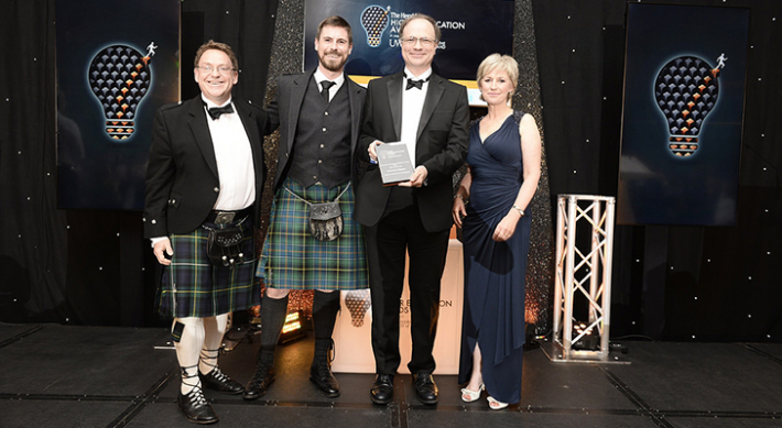 Jason Miles-Campbell presents the University of Glasgow school of mathematics and statistics with the award for Innovation Technology Excellence