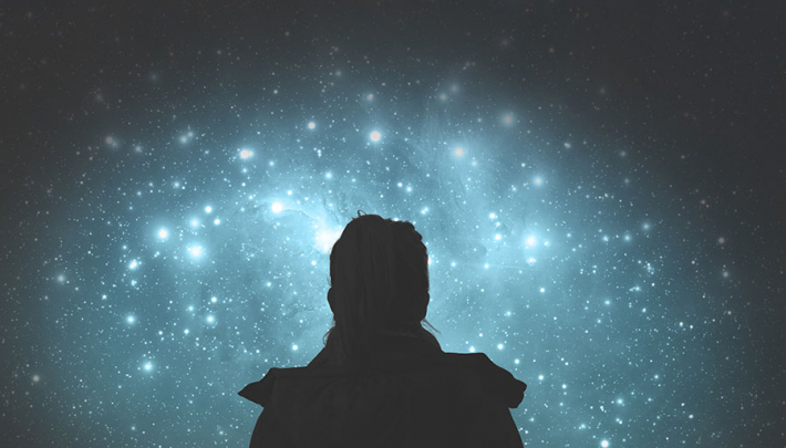 Person looking up into space
