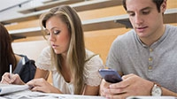 Students using mobiles in a lecture theatre