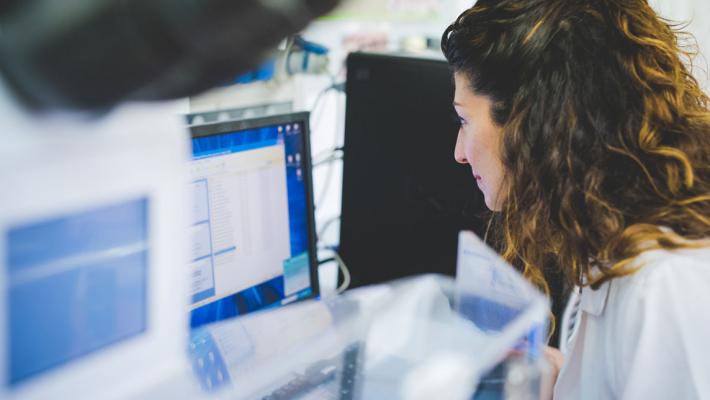 Scientist analysing data