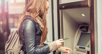 Student at a cashpoint