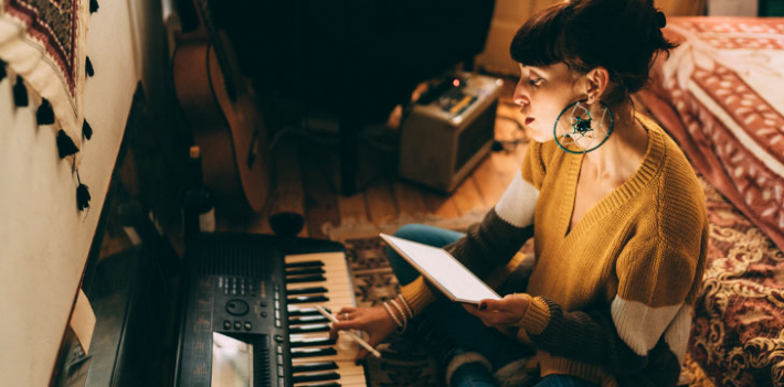 Student composing music at home