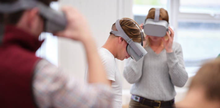 Students using VR headsets in the classroom