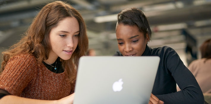 Students working at a laptop