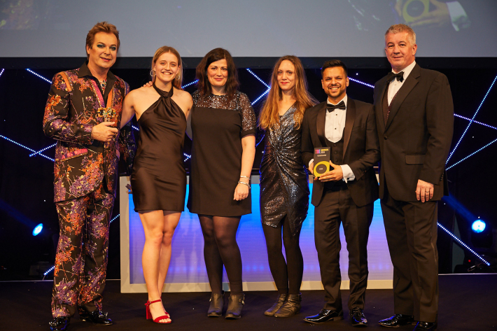Times Higher Education Awards host Julian Clary with representatives of Swansea University and Unitu