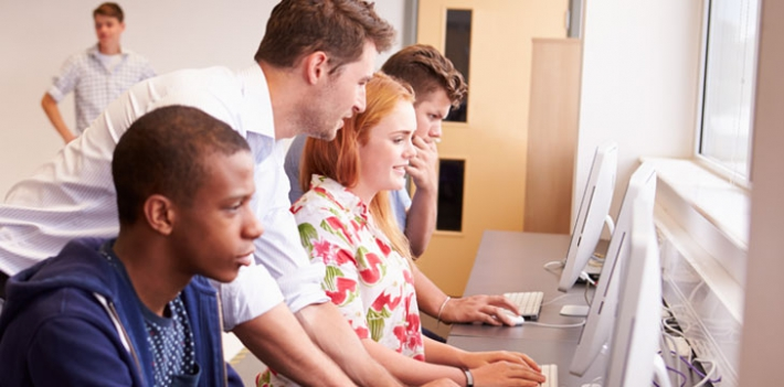 College students and teacher using computers