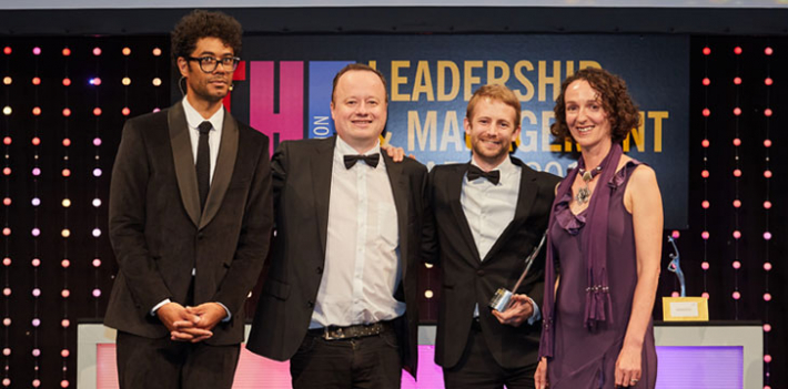 Host Richard Ayoade, two employees of Leeds Beckett University and Jisc's Sarah Davies at the THELMA awards