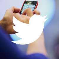 Mobile phone with white Twitter bird overlay