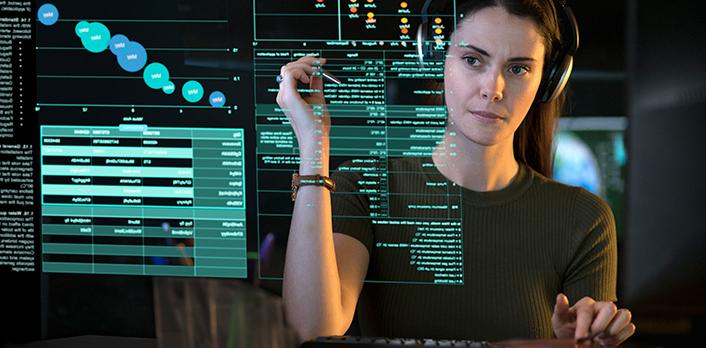 Woman at a data screen