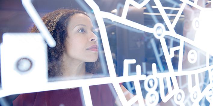 Woman operating digital interface technology