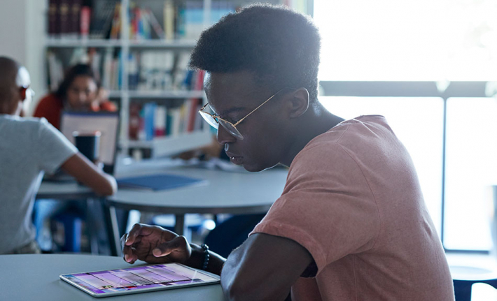 Student using a tablet in the library