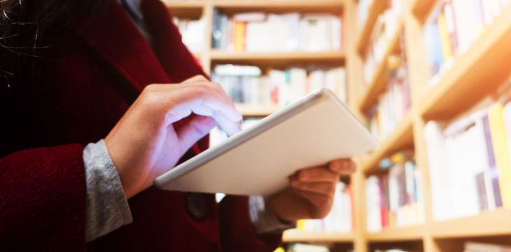 Using a tablet in a library