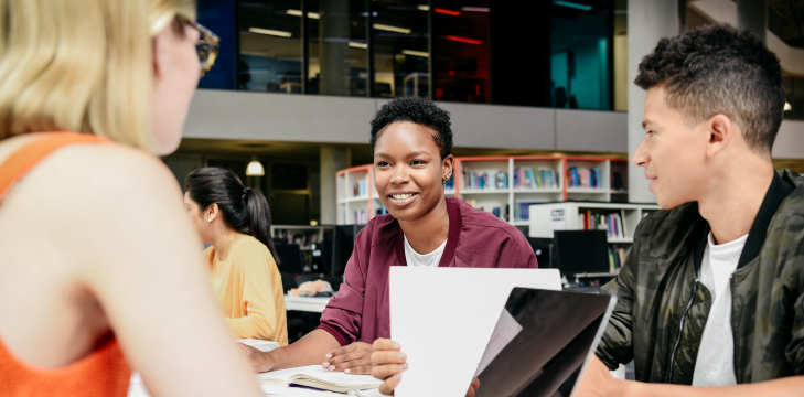 Students studying and talking in the library