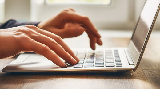 Close up of man using a laptop