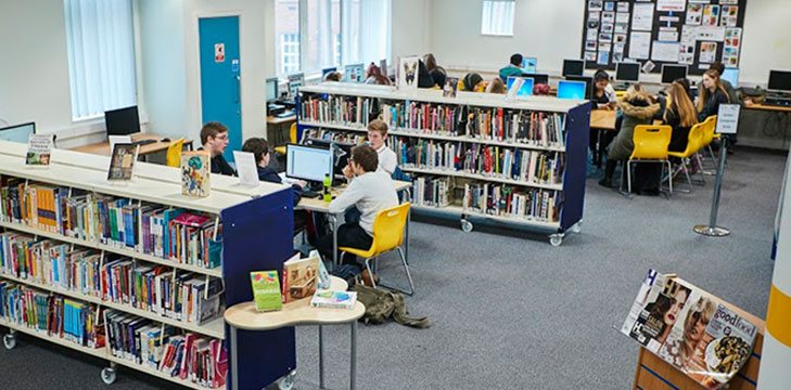 Students in the library at Coleg Cambria
