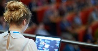 Networkshop45 delegate working at her laptop