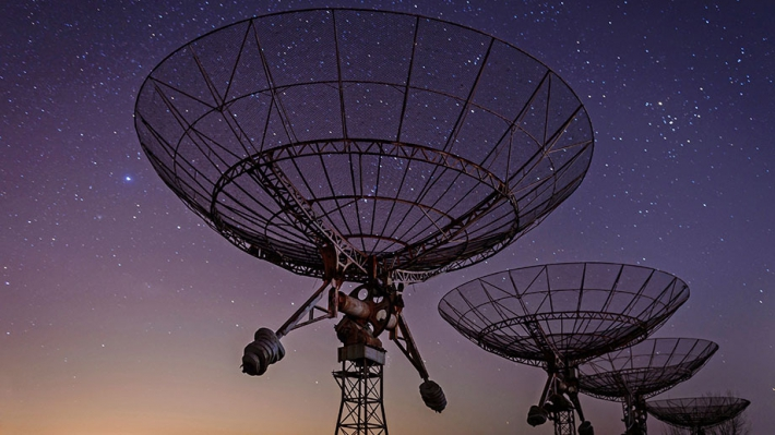 Radio telescopes under a starry sky